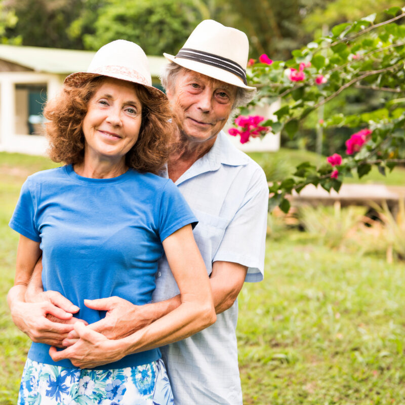 Portrait of a beautiful elderly couple standing embracing outdoors in Costa Rica