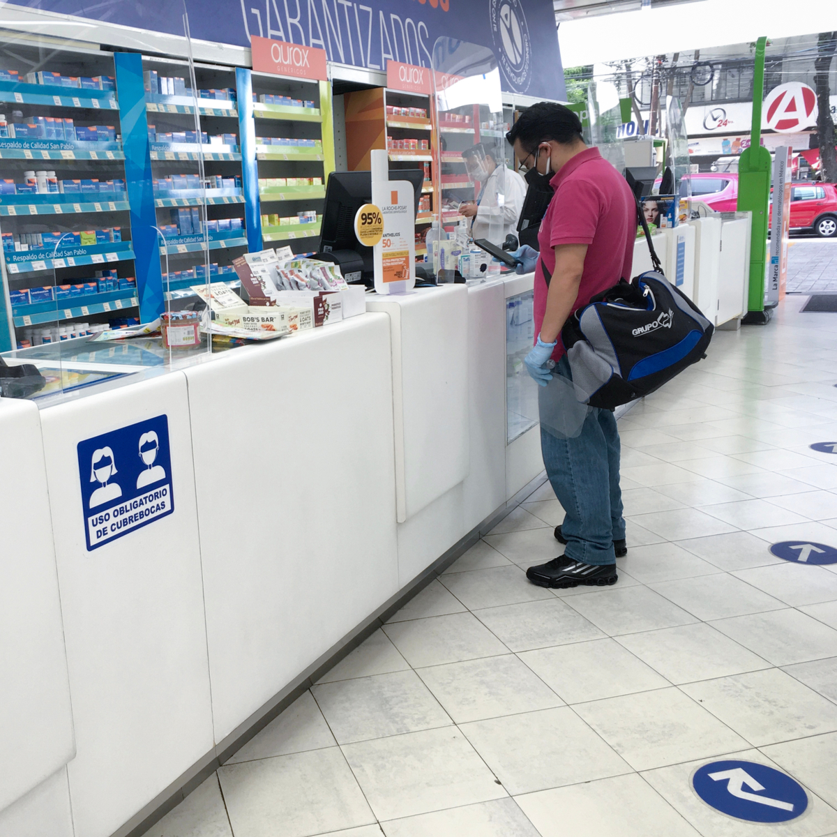 Man stands at pharmacy in Mexico