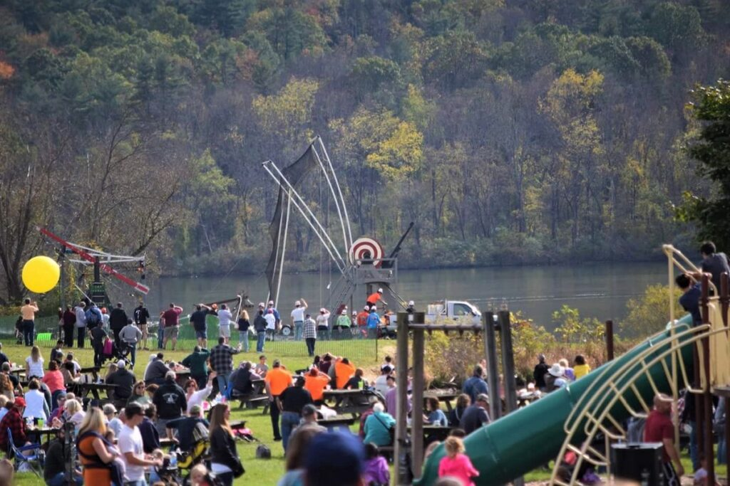 Festival attendees gather by the lake for the Pumpkin' Chunkin' event.