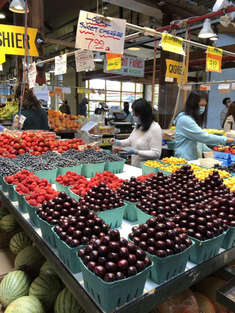 Shoppers collect fresh produce at Granville Island Public Market