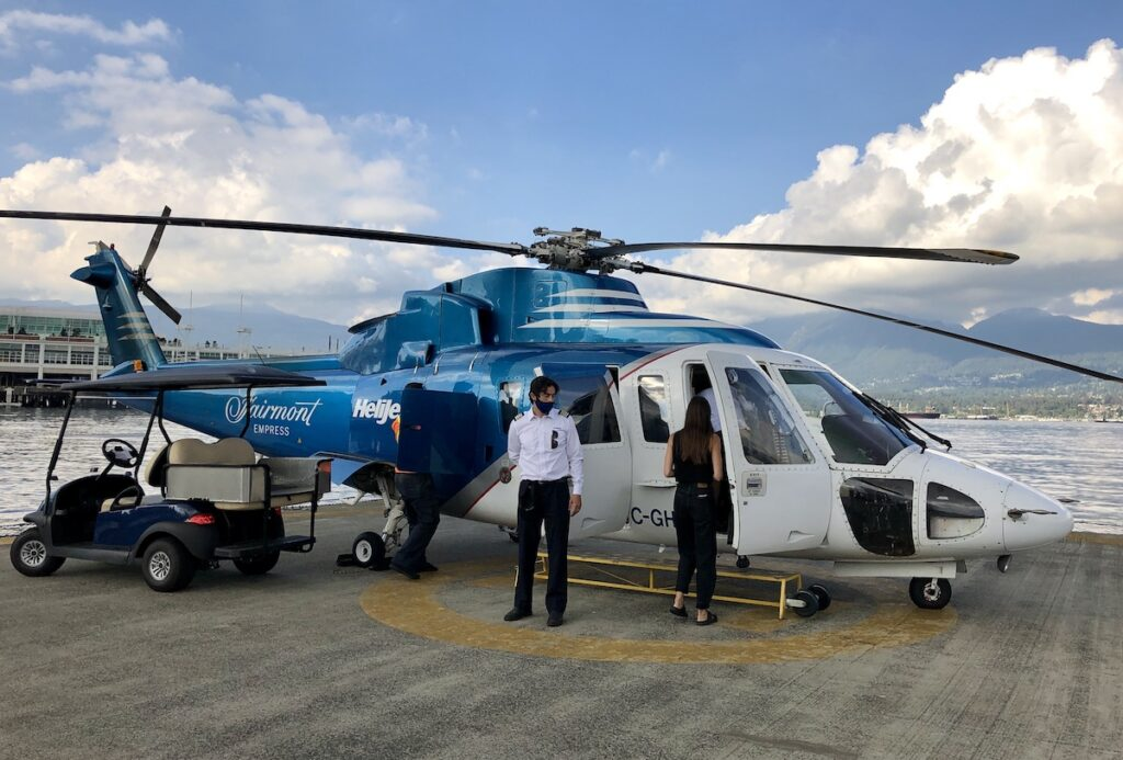 Boarding the Helijet helicopter on a blue sky day.
