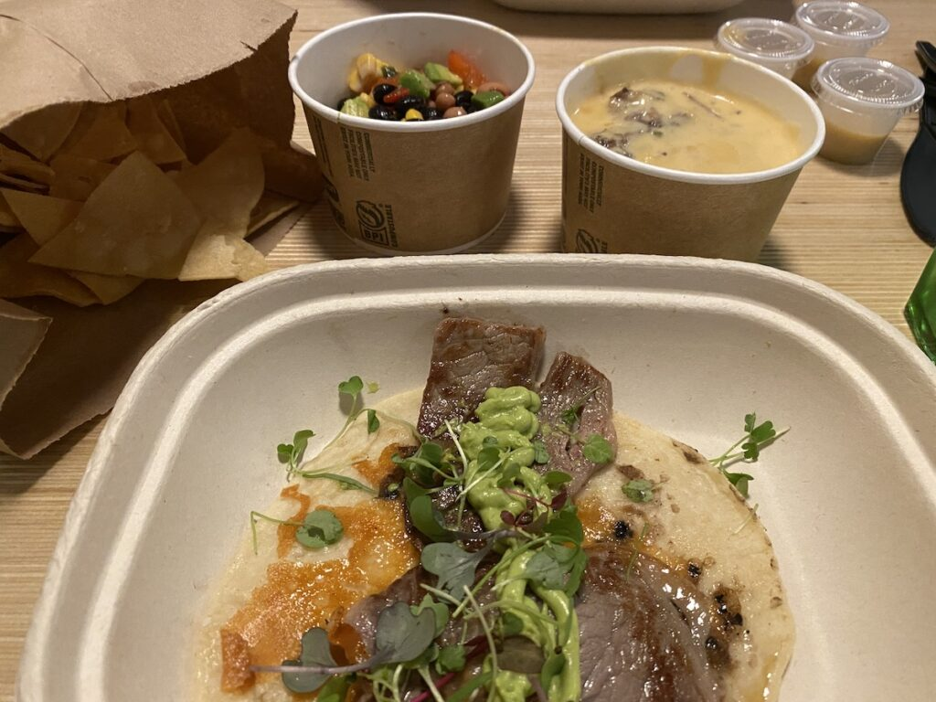 Raised Taco Plate with Taco and two side dishes.