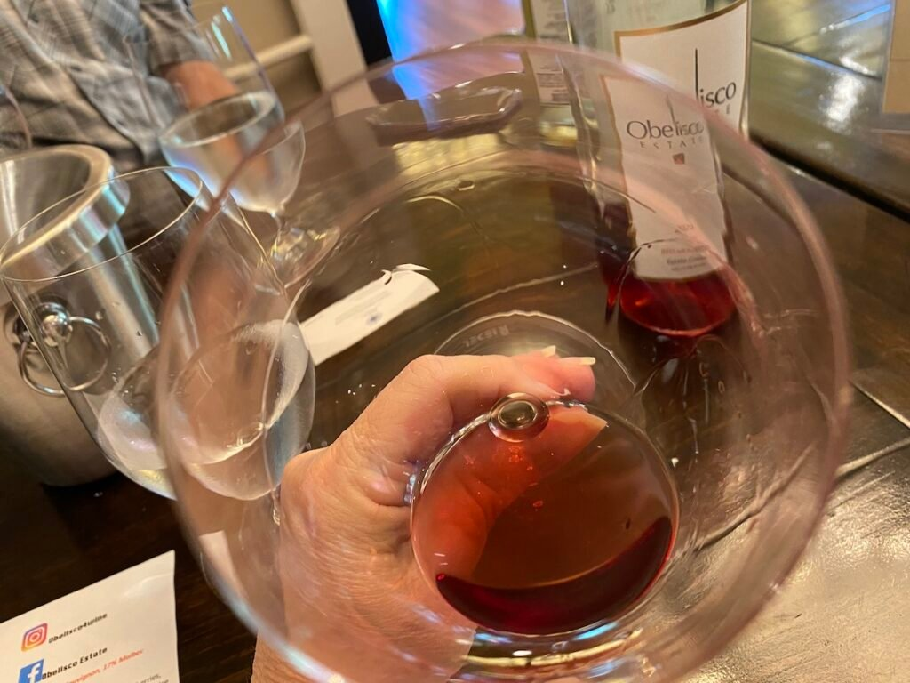 Wine glass with wine, The unique Cabernet Sauvignon Rose at Obelisco Estate.