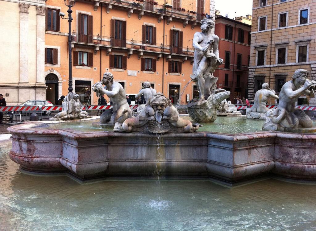 Water fountain of men drinking in Europe