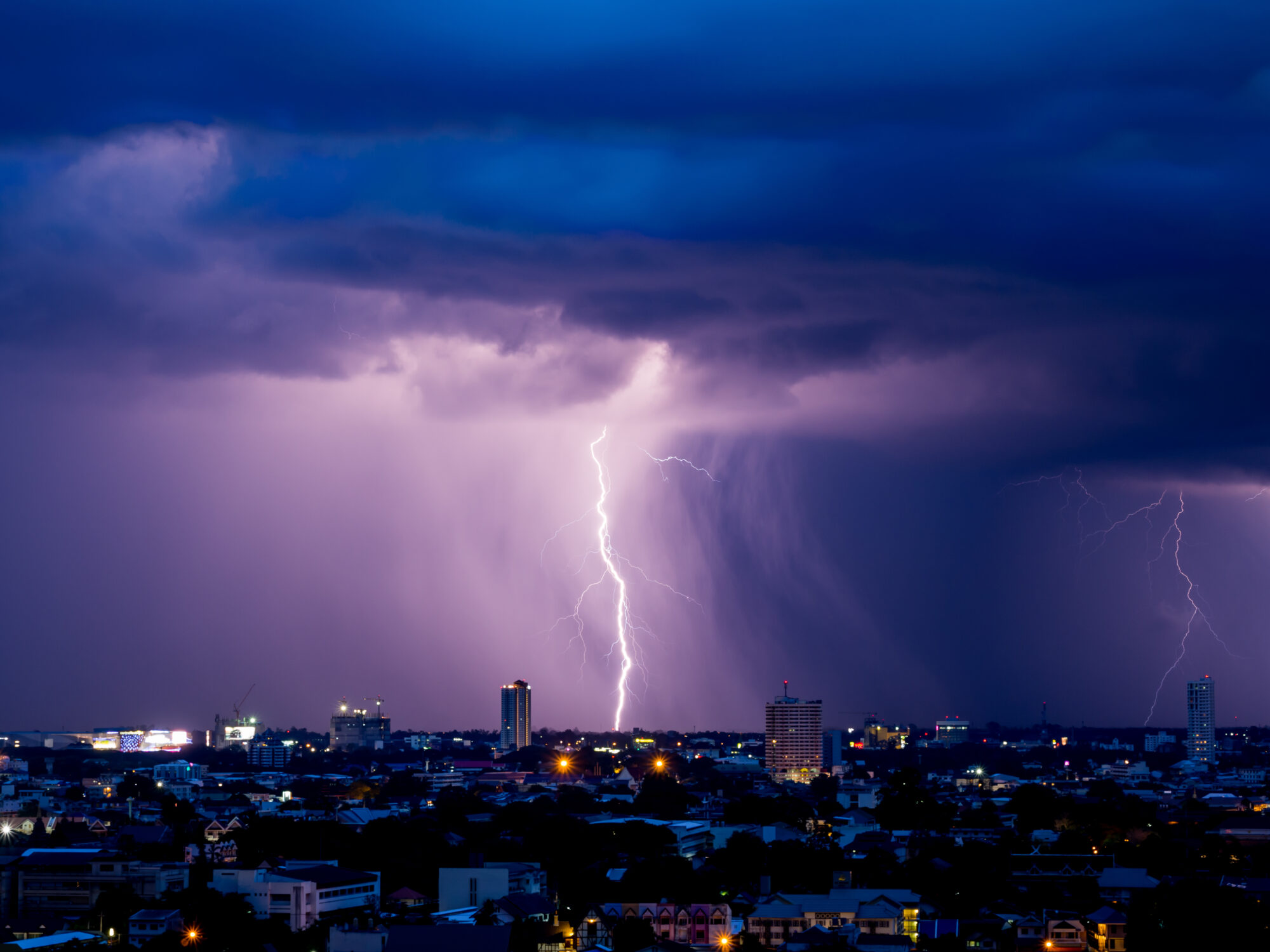 Lightning storm over city losing power electricity