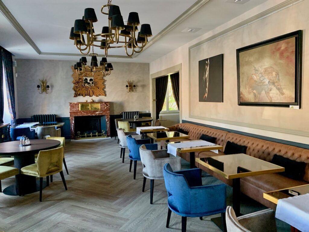 Tea room with blue grey and gold chairs at Loire Valley Hotel.