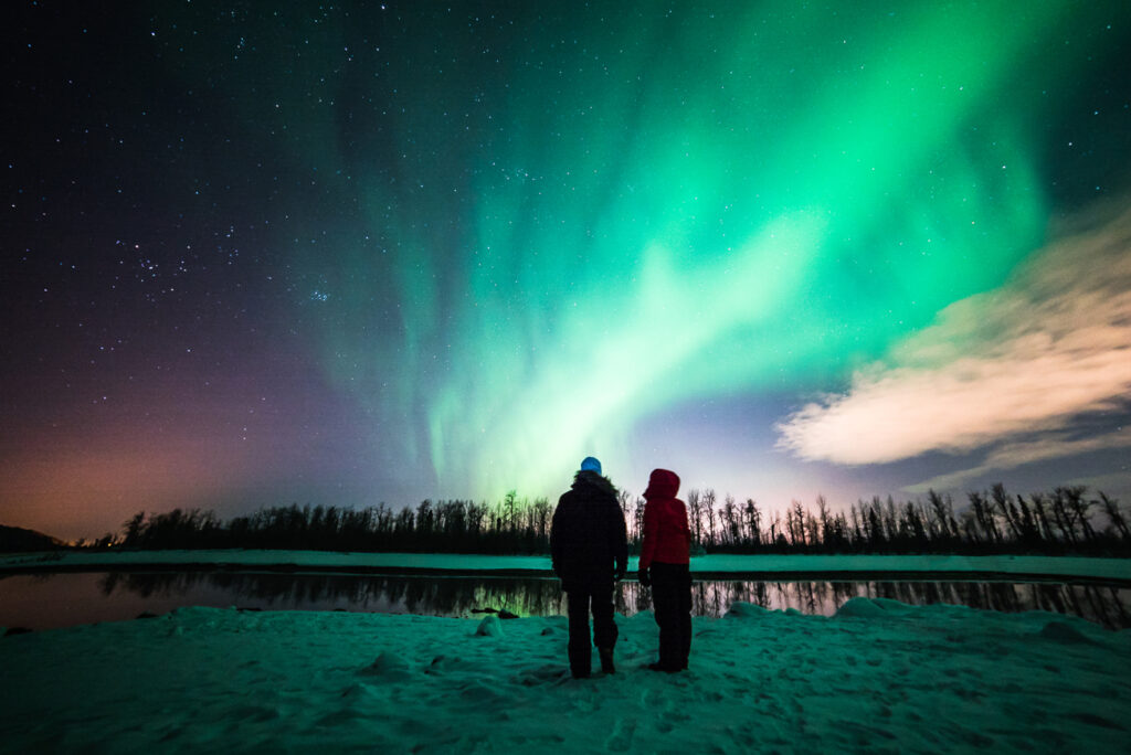 two people viewing the northern lights at Anchorage Aurora Quest in Alaska
