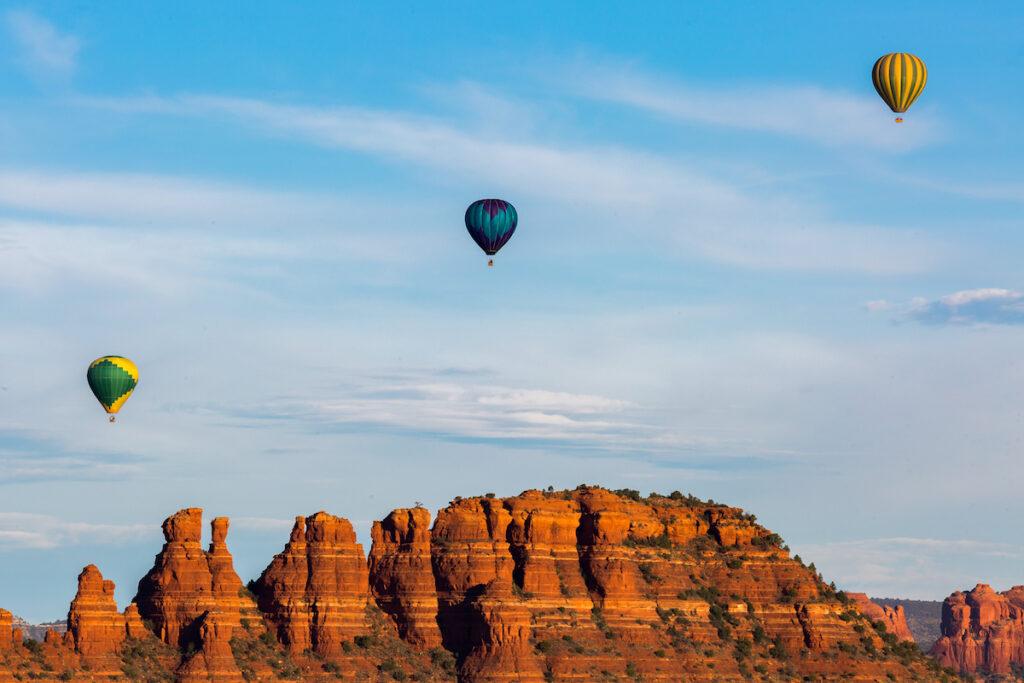Hot air balloons over Red Rocks in Sedona, Arizona.