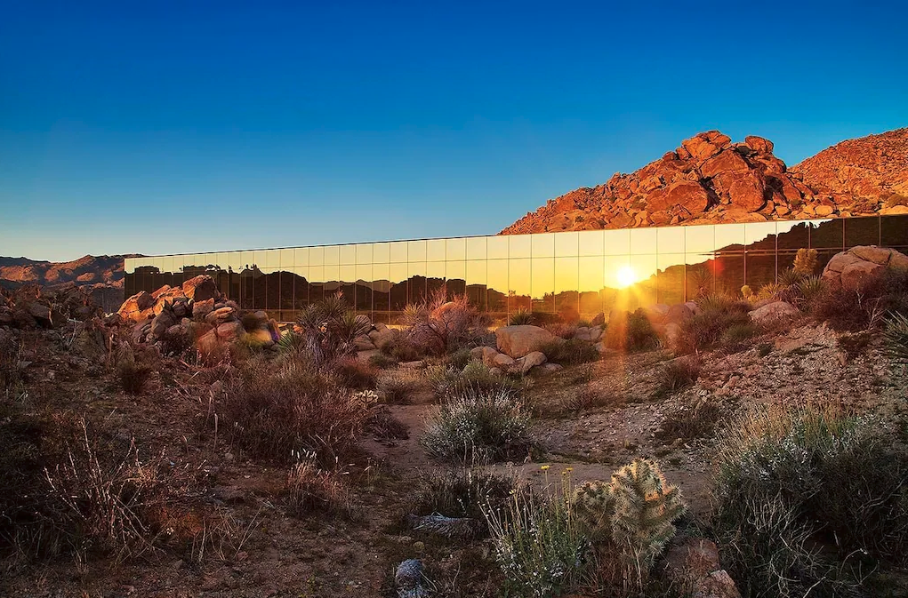 Mirrored exterior of Invisible House in Joshua Tree reflecting sun
