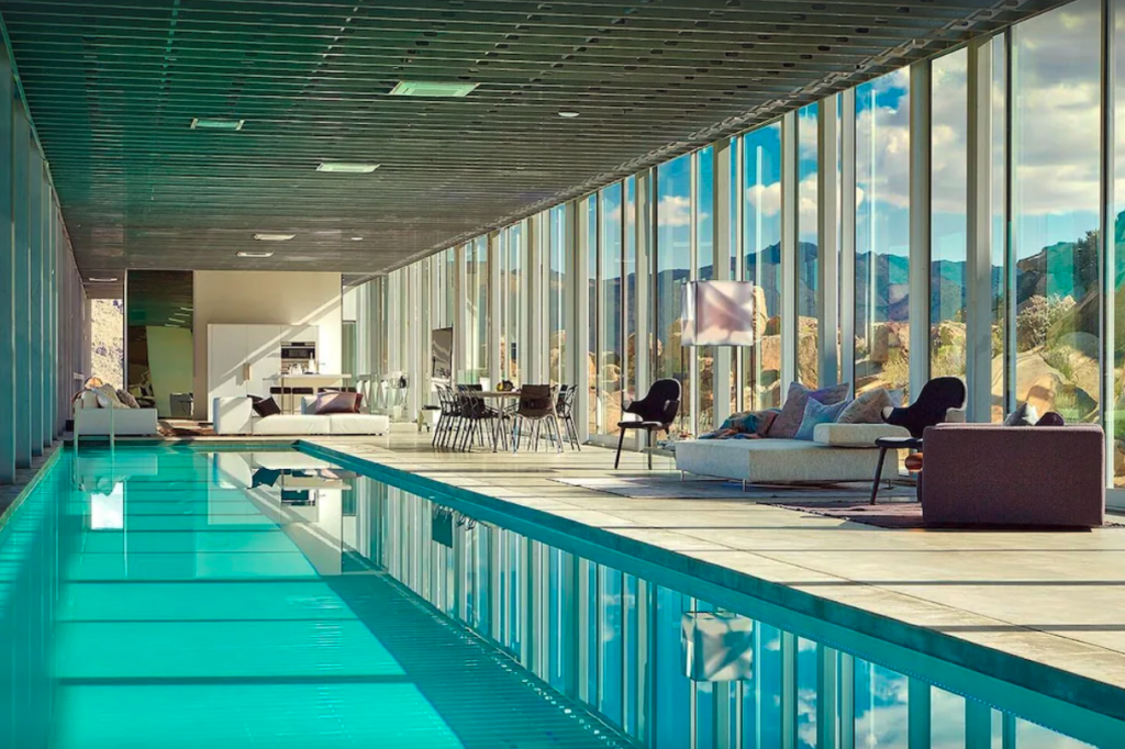 luxurious 100-foot solar-heated indoor swimming pool in Invisible House