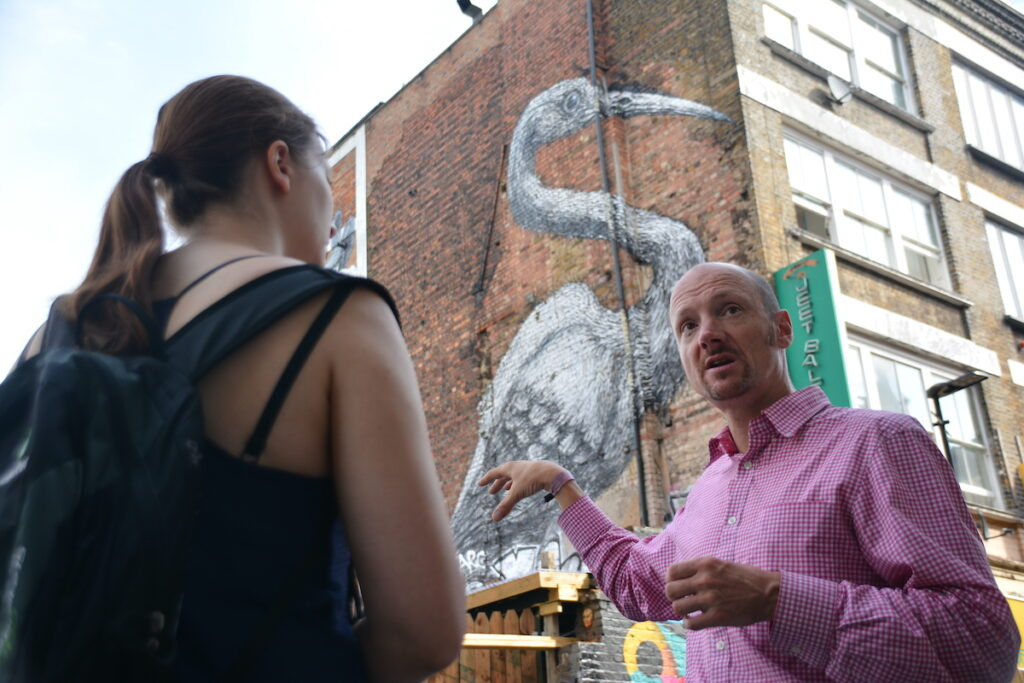 Simon of Tours by Locals leading a walking tour through Shoreditch, London.