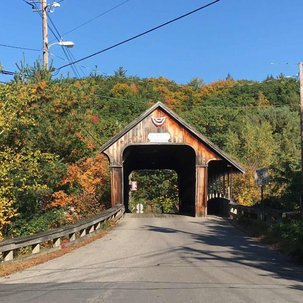 Road leading up to the covered Squam River Bridge in Ashland, New Hampshire.