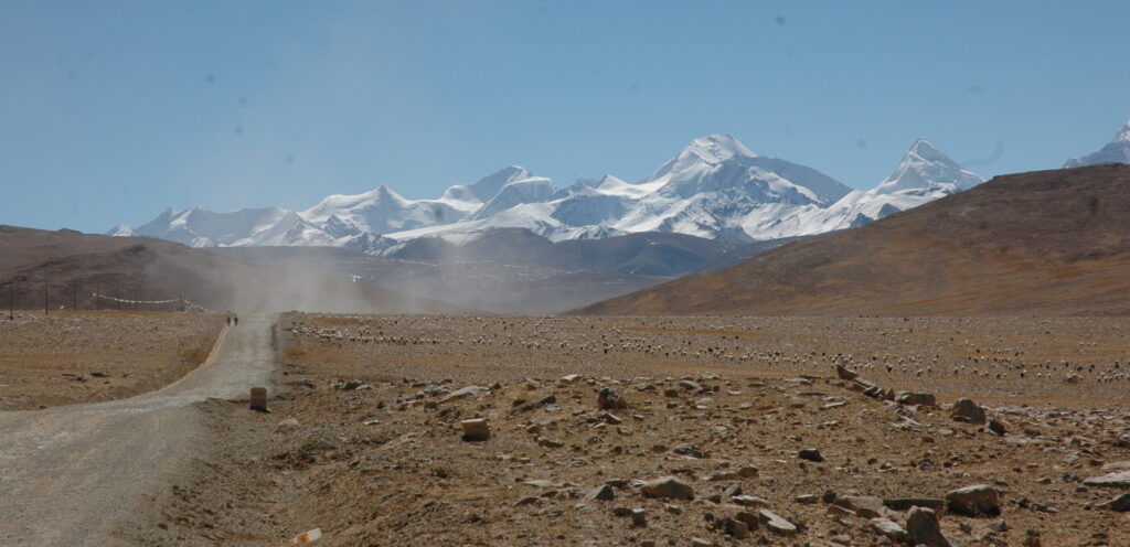 Road from Tibet to Nepal with Himalayan mountains in the background.