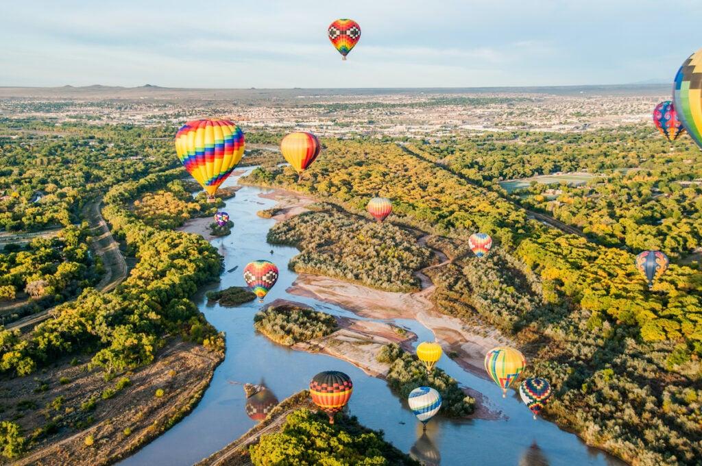 Balloons over the Rio Grande by Albuquerque, New Mexico.