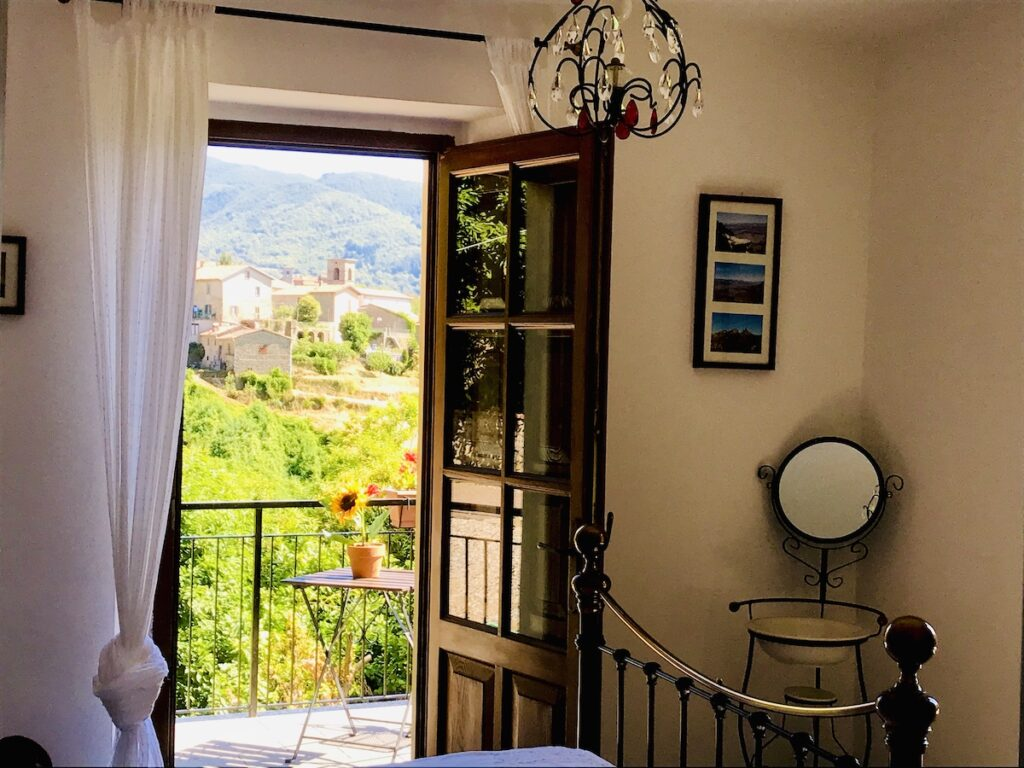 Bedroom with balcony overlooking the village.