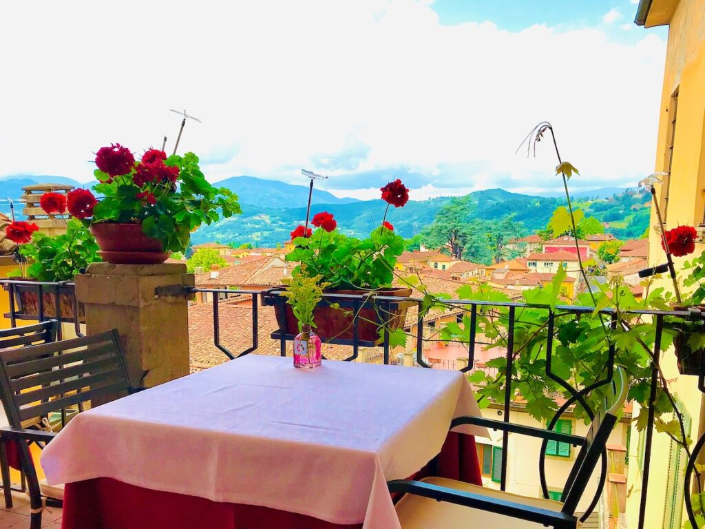 The outdoor seating area with balcony overlooking the village of Garfagnana.