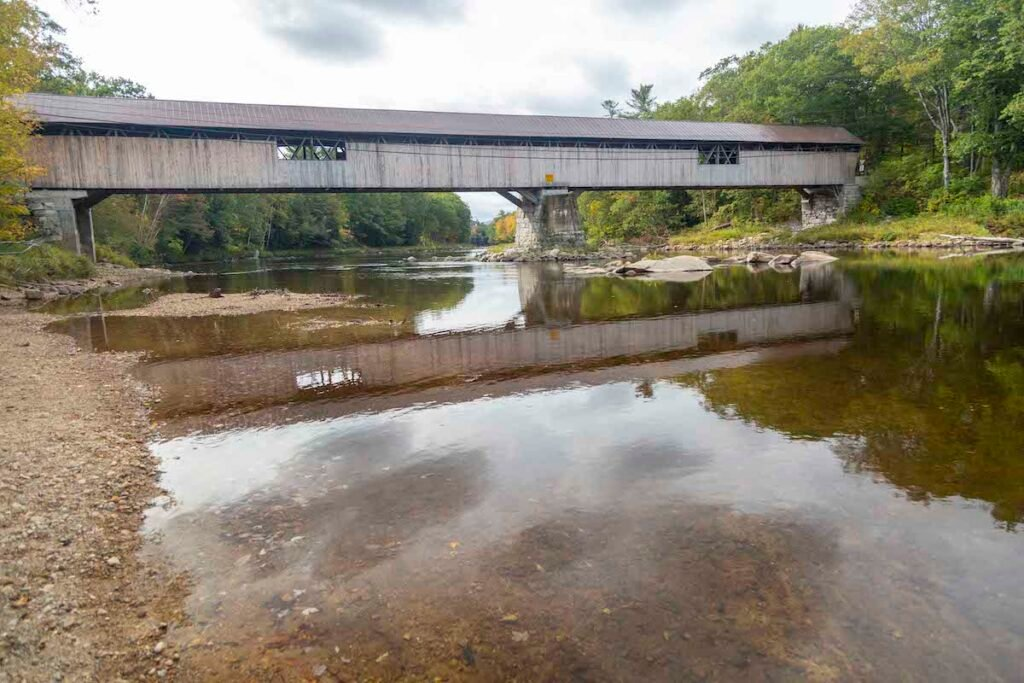 Picture of Blair Bridge in Campton, New Hampshire, from the water of the Pemigewasset River.