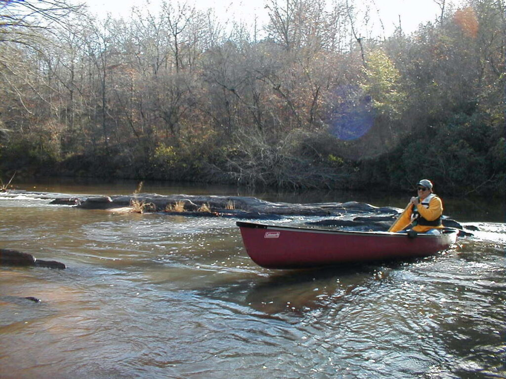 Joe Cuhaj canoeing on one of Alabama's many rivers.