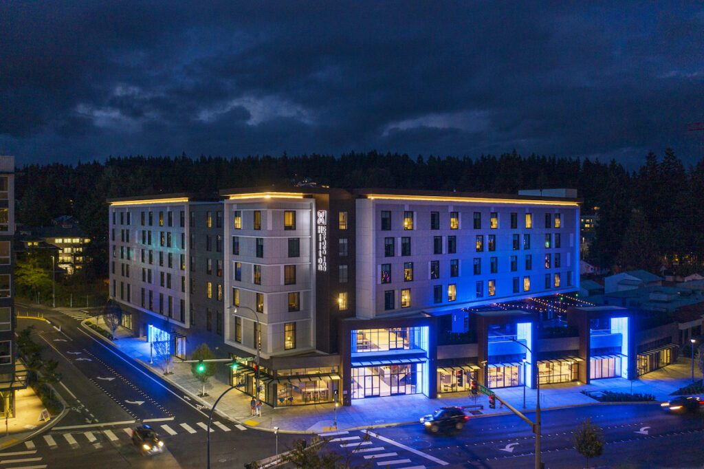 Hilton Garden Inn Redmond at night with blue lights.