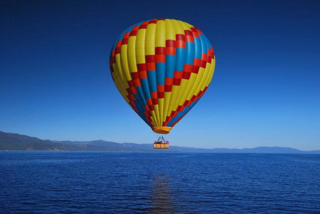 Hot air balloon over Lake Tahoe in California.