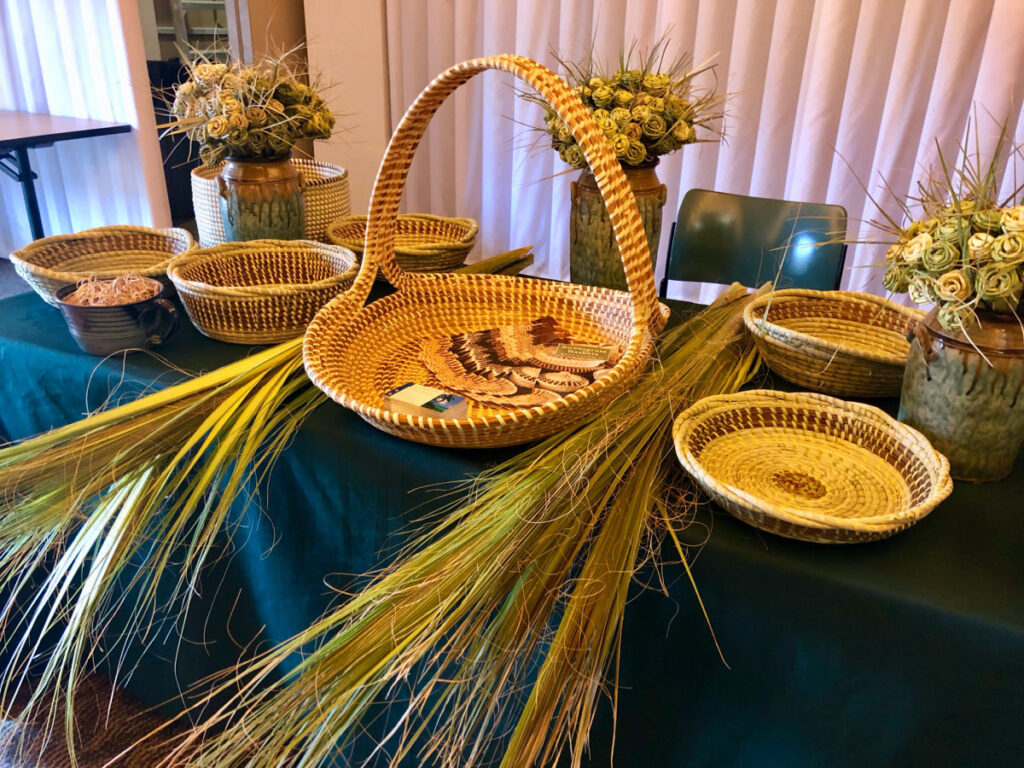 low country sweetgrass baskets sitting on display table.