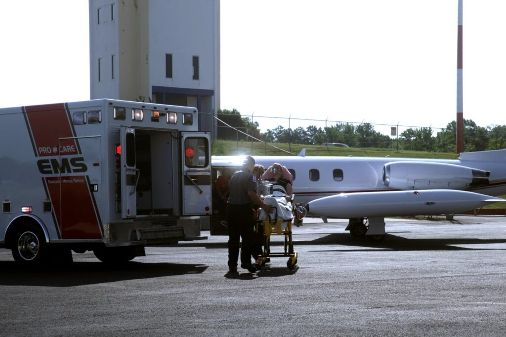medjet emergency medical transferring patient to air ambulance plane