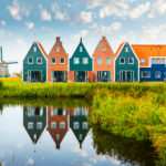 Town houses set along a body of water in the town of Volendam in North Holland, Netherlands.