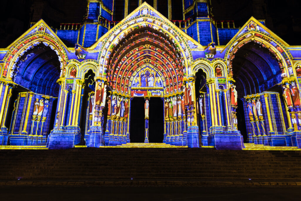 Building facade light festival Chartres in France.