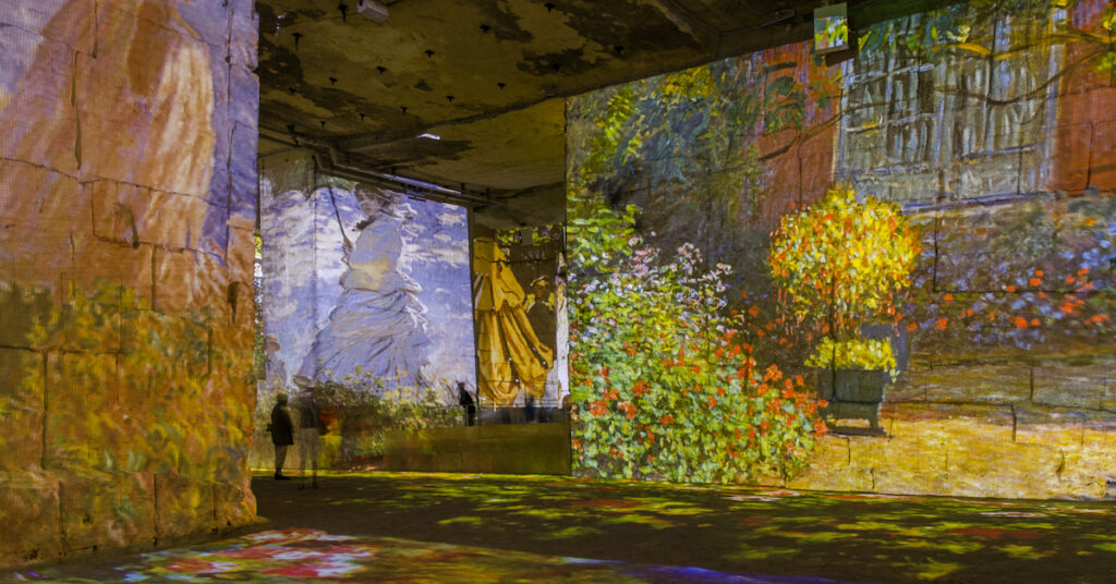 View of the light exhibition at the  Carrieres de Lumieres where famous paintings are projected onto the walls.