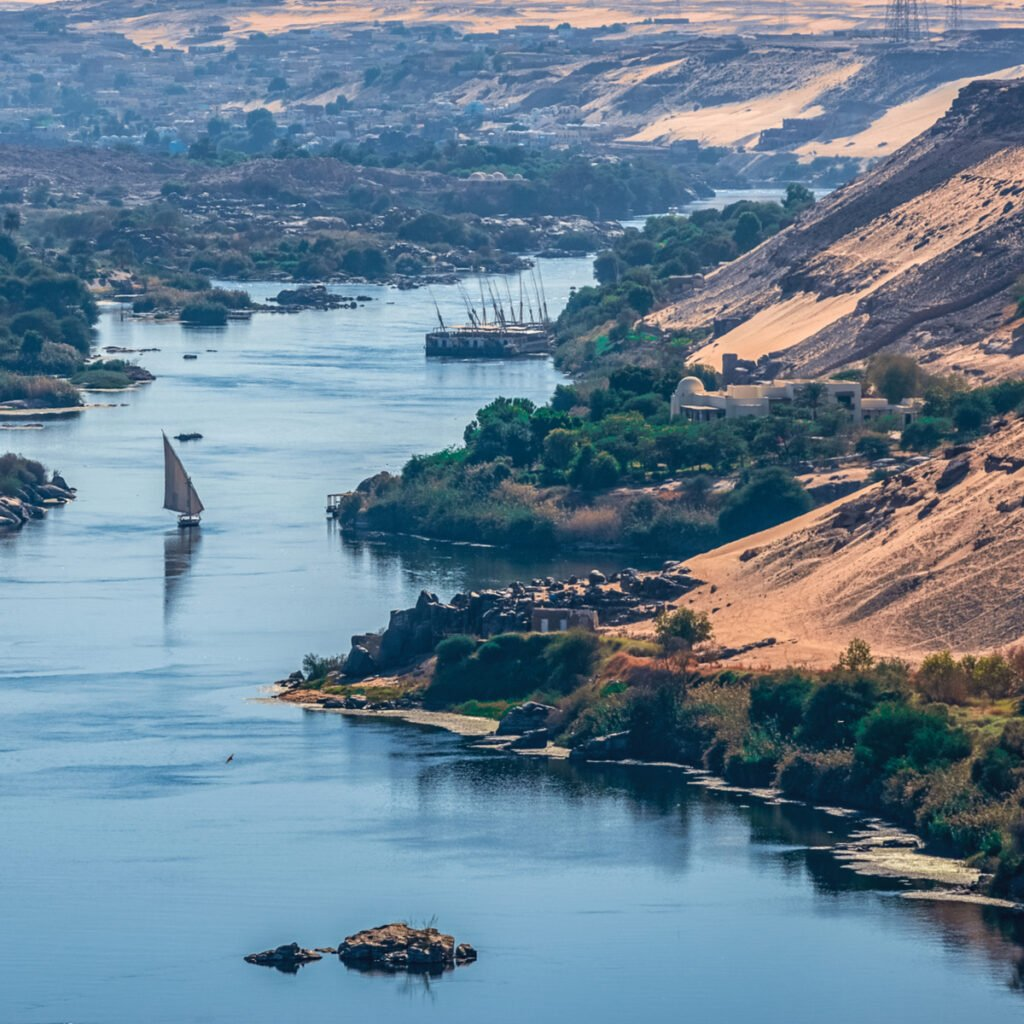 Sunset over the Nile River in the city of Aswan with sandy and deserted shores.