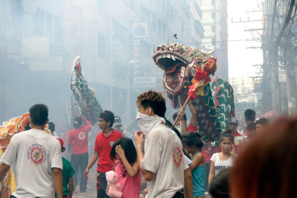 Dragon dance performer during the celebration of the Chinese New Year in Binondo Manila Philippines.