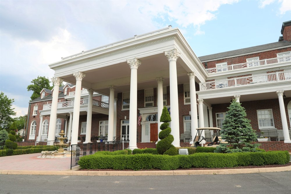 The Historic Mimslyn Inn in Page County, VA is a Georgian Revival Building that features a front portico and was built from 1929 to 1931