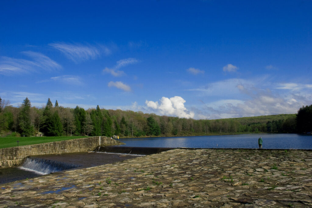 A man fishing on the lake at Parker Dam State Park, Pennsylvania.