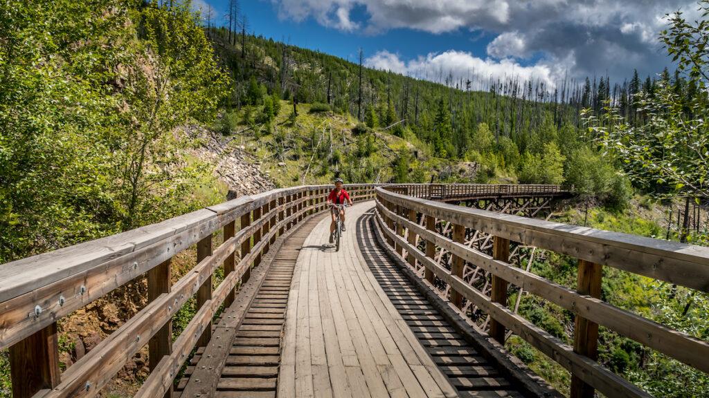 Biking over the Wooden Trestle Bridges of the abandoned Kettle Valley Railway in Myra Canyon near Kelowna.