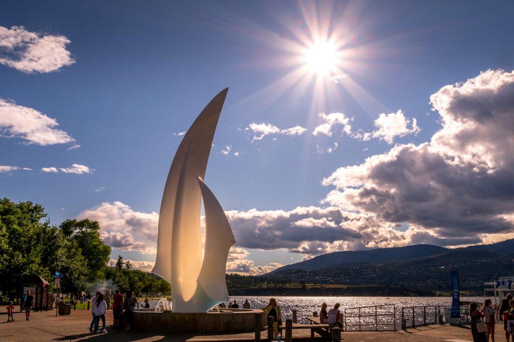 Sunset over the iconic fiberglass sculpture 'Spirit of Sail' at the City Park of Kelowna at the bottom of Bernard Avenue.