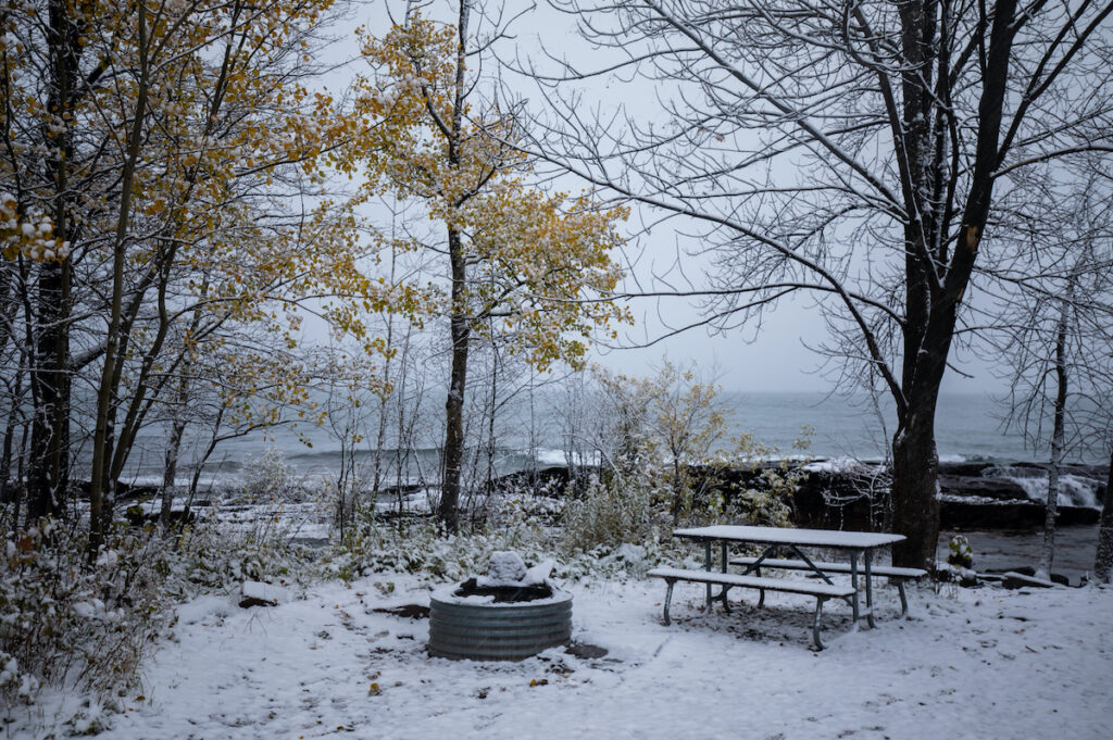Camp site in the snow at Union Bay Campground by Lake Superior. Cold weather winter camping. Porcupine Mountains Wilderness State Park .