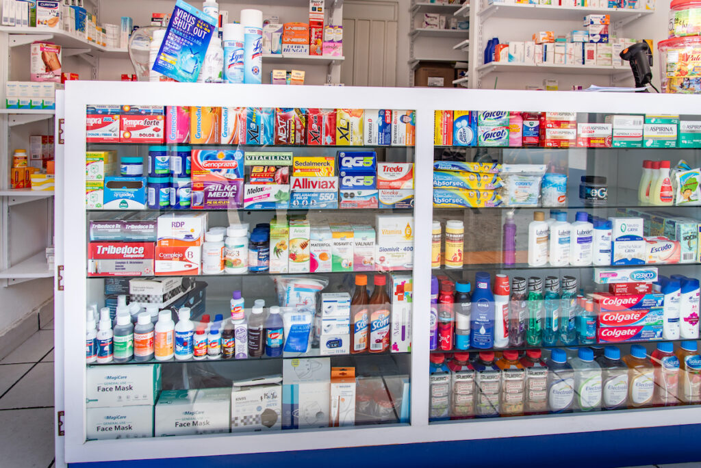 Mexican pharmacy sideboard showcase with multicolored medicine boxes.
