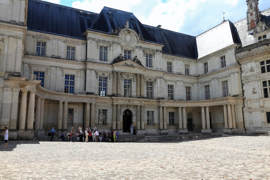Tourist walking on the grounds of the Chateau-de-Blois, one of the largest castles in the Loire Valley.