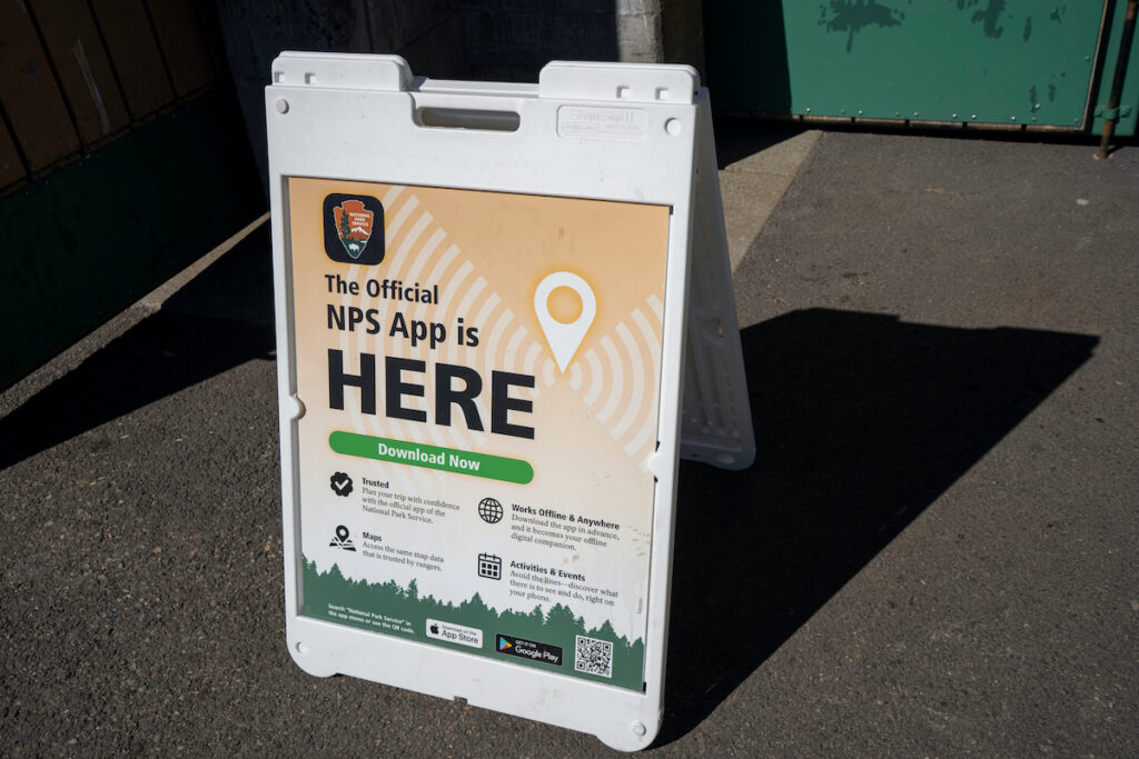 A sign outside advertising the official NPS  app.
