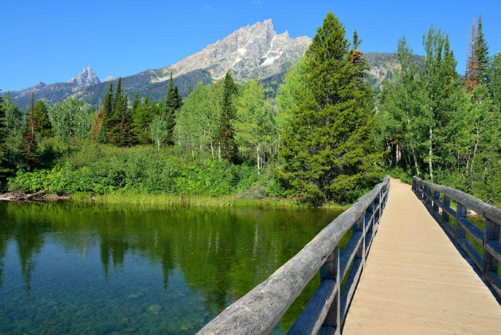 Bridge across Jenny Lake in Grand Teton National Park in Summer.