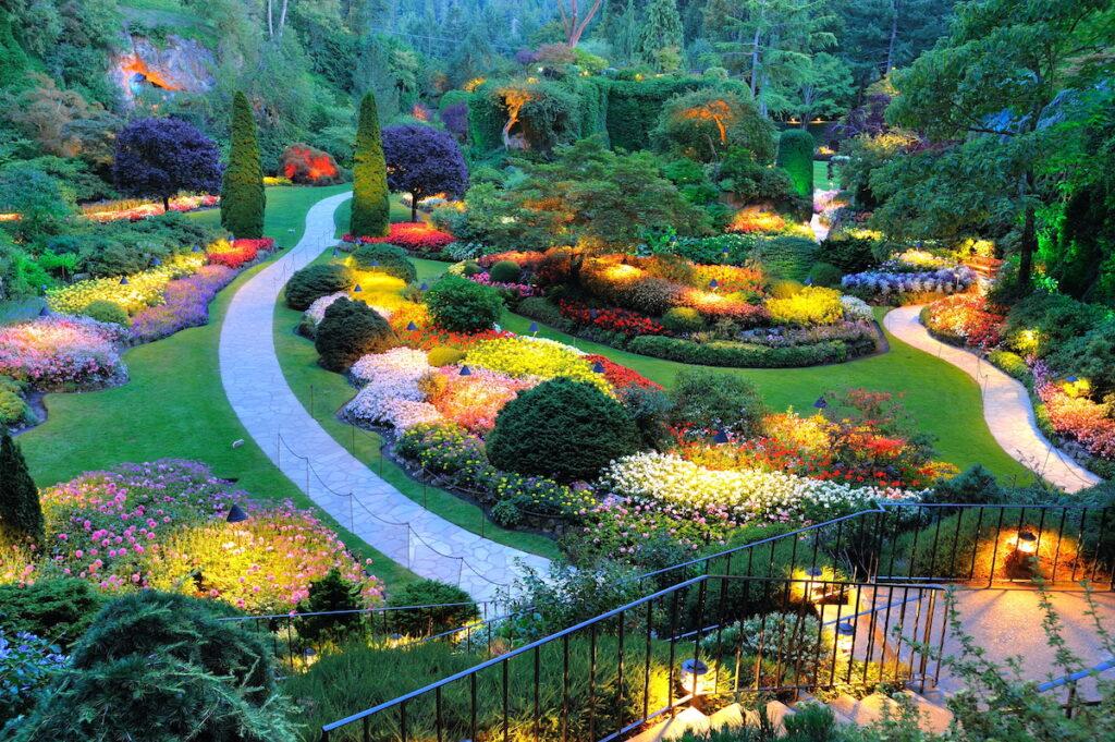 Summer beautiful sunken garden night scene at the historic Butchart Gardens, Victoria, British Columbia, Canada.