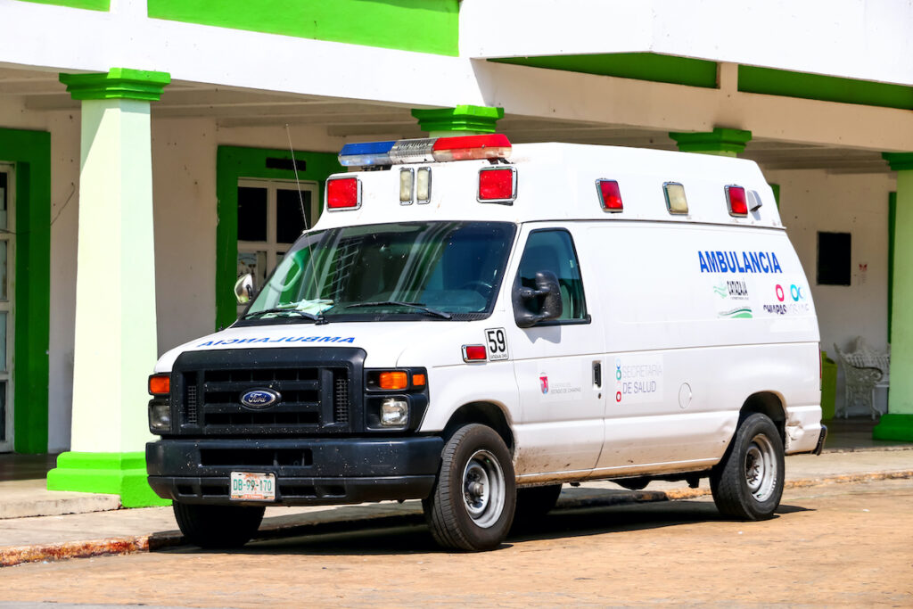 White ambulance vehicle Ford E-series in the city street in Catazaja, Mexico.
