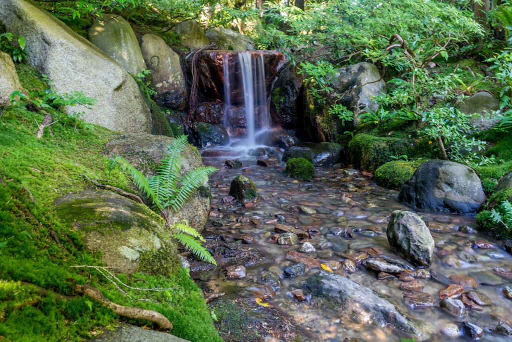The Nitobe Memorial Japanese Zen Garden with waterfall and stream.