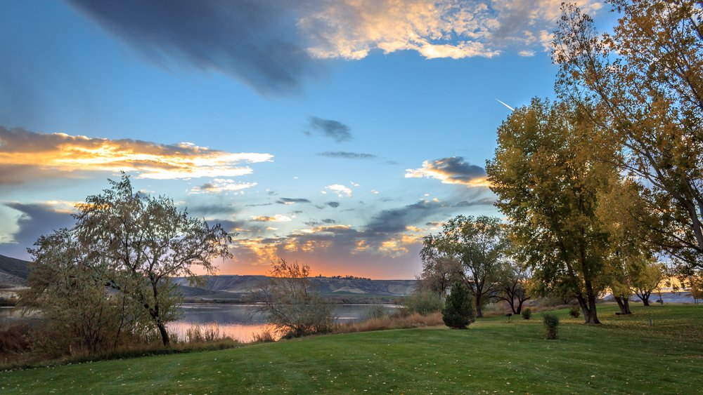 The sun sets in the fall along the Snake River at Three Island Crossing State Park, Glenn's Ferry, Idaho, USA