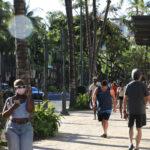 Masked pedestrians in the Waikiki neighborhood of Honolulu, Hawaii.