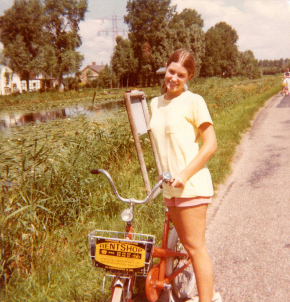 Girl on tour in the Netherlands pulled over to the side of a road with her bike rental.