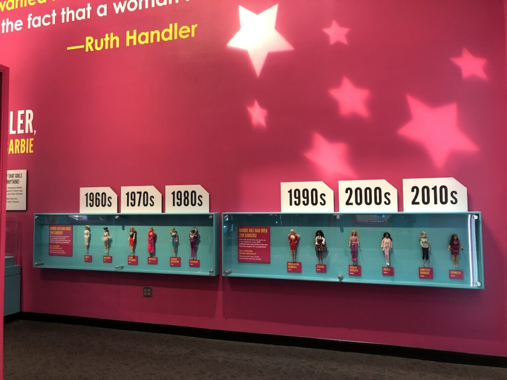 Barbie through the years, display of different barbies and her costumes.