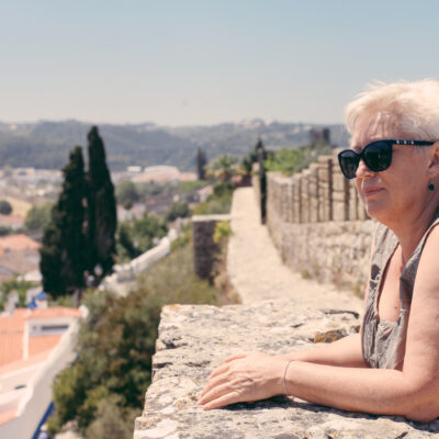Senior woman lady tourist in an old city of Europe