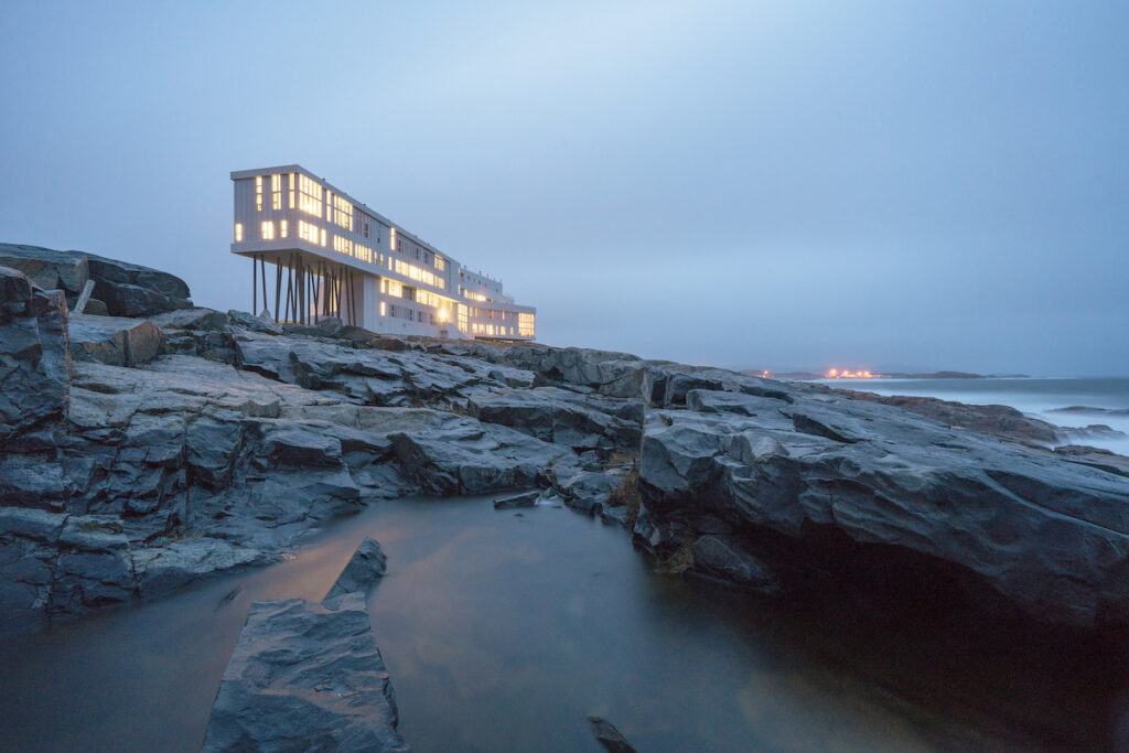 Exterior and landscape of Fogo Inn on a cloudy early morning.
