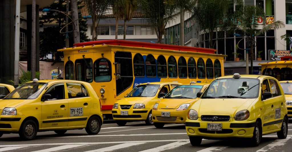 Taxis on a street in Medellin, Colombia